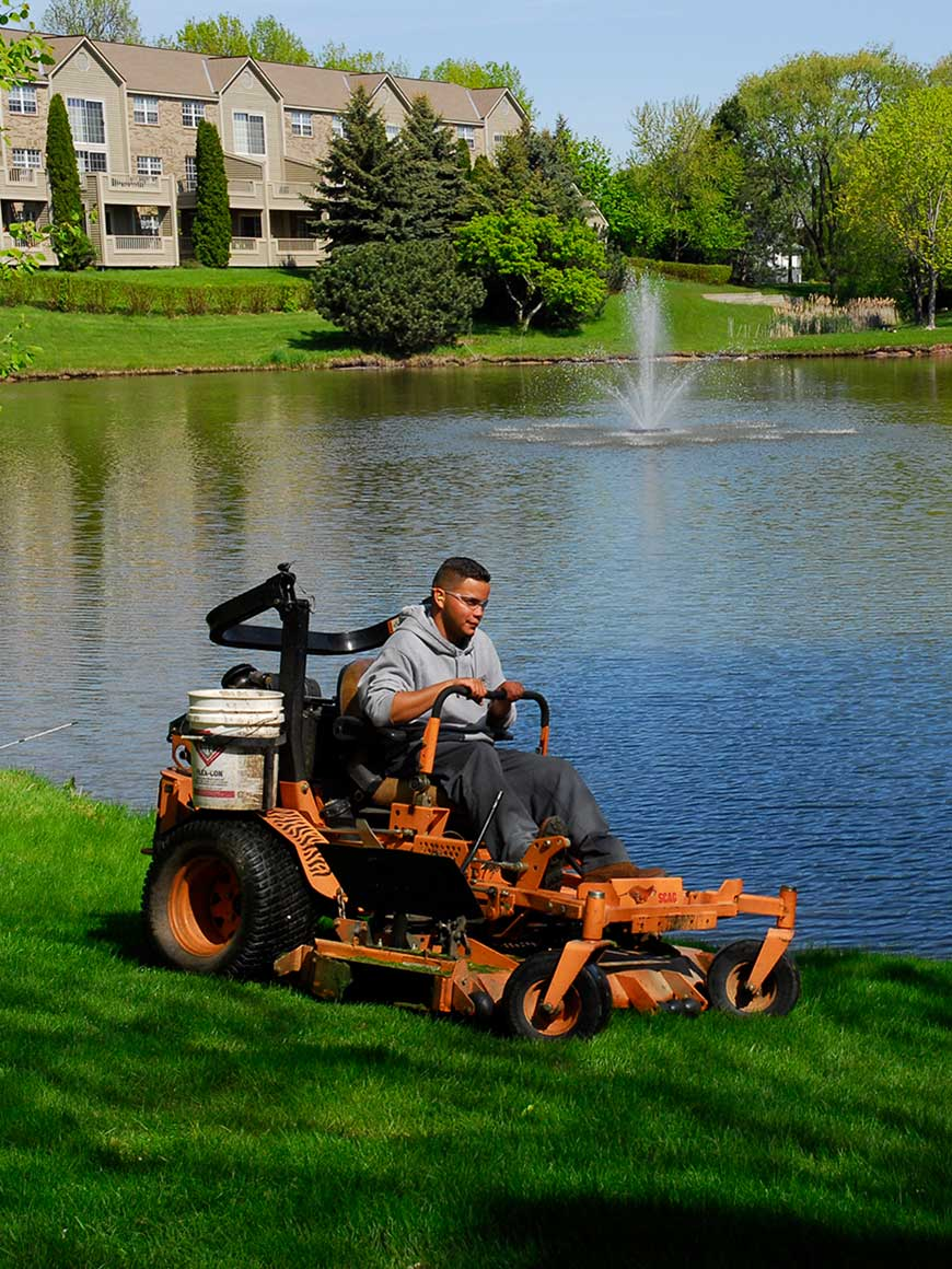 LaRosa Employee Mowing Property